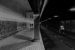 black in white & white in black (Gerrit-Jan Visser) Tags: amsterdam bicycle blackwhite streetphotography tunnel blackandwhite contrast pedestrians city pov flickrfriday transport shadow lights