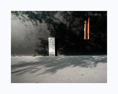 Au ras des pâquerettes (hélène chantemerle) Tags: rue mur soleil été ombre sol ouverture meutrière boîte noir rouge street wall sun summer shadow ground loophole box black red
