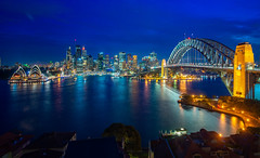 Sydney harbour and bridge in Sydney city (anekphoto) Tags: sydney harbour bridge australia city panorama night cbd skyline landmark harbor sunset panoramic water opera cityscape new wales dusk lights architecture building reflection tourist landscape nsw house south modern light holiday blue kirribilli bay urban evening downtown twilight summer sky travel sea tower colour famous view illuminated blurred destinations arch