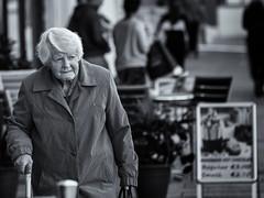 Elegant older lady (Frank Fullard) Tags: frankfullard fullard candid street portrait lady older elderly stick crutch elegant walk tralee kerry irish ireland stroll monochrome black white blanc noir