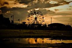 Funfair reflection (jimiliop) Tags: funfair wheel sunset reflection sky afterrain