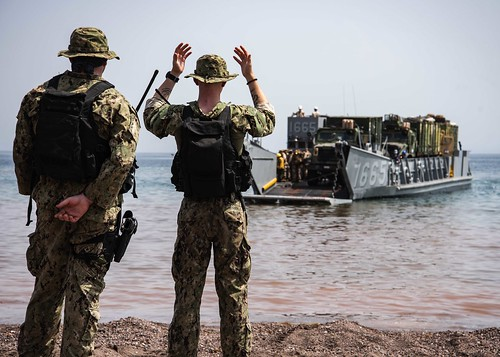 Sailor signals a landing craft utility