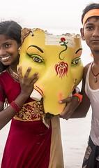 Siblings. (SriramK10) Tags: pray hinduism religion idol smile happiness happy sea beach 50mm nikond5500 vinayakachathurthi ganeshachathurti lordganesha ganesha orange yellow red colorful portrait