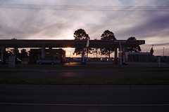 Gas (OzGFK) Tags: ricoh35zf film analog iro200 filmneverdie fuji200 fujic200 urban streetphotography 35mm altona sunset dusk evening petrolstation gasstation clouds