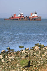 Pocahontas and her sister (Gunn Shots.) Tags: sanpablobay chinacamp fivepinespoint tugboat bay stones rocks water