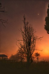 Sunrise glow as the crescent moon fades away .. (Funafrica) Tags: sunrise crescentmoon landscapes
