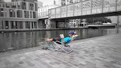 Chilling on canal docks (vincentag) Tags: paris france canal docks rocking chair man reading