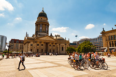People on bicycles (Raoul Pop) Tags: relief bicycle historic people person descriptor cobblestone structure restoration time technology plaza statue travel neoclassic architecture rotunda object sunlight column tourist act portico trip berlin germany de