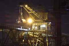 Manga's Metal (Robin Shepperson) Tags: yellow machine digger industrial industry light lights le longexposure berlin germany night dark huge starburst d3400 nikon engineering bridge grafitti
