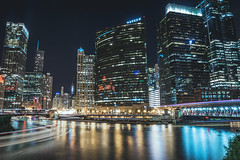 A City of Lights (tylerjacobs) Tags: sony a6000 sigma 16mm 14 long exposure longexposure chicago illinois metropolis downtown skyscrapper buildings cities towers night nightsky sky light trails lighttrails summer warm the l river boat train