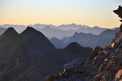 Evening view over the Alps of Graubünden (echumachenco) Tags: view panorama mountains mountain mountainside peak crest ridge lines valley haze evening sky sunset outdoor landscape serene alps grisons graubünden grischun pizlanguard engadin oberengadin pontresina switzerland schweiz suisse svizzera svizra suiza nikond3100 rock stone rubble