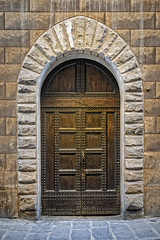 Studded Timber Doors, Florence_1 (Tony Steinberg Photography) Tags: aged ancient antique arch architecture archway background blocks bricks brown building chocolate close closing cobblestone distressedlook door doorway entrance entry façade floor fortified front gothic handle historical history home house keyhole keystone lock masonry medieval metal old open opening orange ornate pavers portal reinforced residence residential sandstone shadeofbrown stone strength strong structure studs threshold tiles timber traditional vintage wall wellused wood wooden