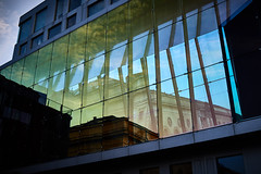 Will it stand the test of time as its neighbour? (iamunclefester) Tags: munich münchen reflexion window facade colorful blue sky shadow