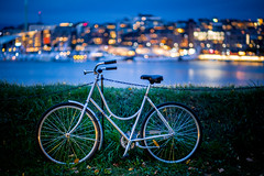 should I stay or should I sail ? ((:Andrzej:)) Tags: oslo oslofiord bicycle night bluehour citylights bokeh