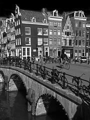 Keizersgracht (RobertLx) Tags: bike bicycle building city canal keizersgracht bridge leliegracht monochrome bw black street netherlands europe architecture amsterdam