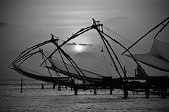 Here's to a Speedy Recovery Kerala! (The Spirit of the World ( On and Off)) Tags: kerala cochin nets fishing fishingnets bw water seascape waterscape india posts pillars industry sun sunset light dusk evening sad mood atmosphere