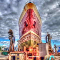 Dry dock (Marion McM) Tags: torshavn harbour drydock ship hull clouds hdr tonemapped photomatix red metal industrial dockyard faroes faroeislands canonpowershotg7xmarkii vibrant