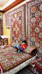 Carpet seller 😃 (MasMozaffary) Tags: persiancarpet carpet child game mobile isfahan iran