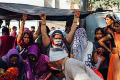 Women Tying Mouli  Threads During Holi, Vrindavan India (AdamCohn) Tags: adamcohn hindu india vrindavan charandu holi kalava mauli moui pilgrim pilgrimage pooja puja sarees sari कलावा मौली होली