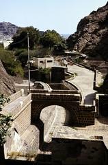 Aden - Tawila Tanks Outlet 2 (motohakone) Tags: jemen yemen arabia arabien dia slide digitalisiert digitized 1992 westasien westernasia ٱلْيَمَن alyaman kodachrome paperframe