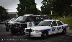 Yonkers Police Vehicles Parked at the Headquarters (nyfrp) Tags: new york city bronx yonkers ny state nyc uptown harlem manhattan train subway police cars pd department tahoes fpius ford interceptor utilities chevy chevrolet ssv spotlights lights vans crown victoria cvpi headquarters talking parked street