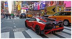 ZOOM! - Times Square, NYC (TravelsWithDan) Tags: lanborghini fastcar performancecar supercar orange candid nyc timessquare newyork city urban street island ads canong3x