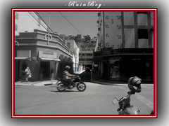 Following the movements of my city ... (Guilherme Alex) Tags: avenue downtown city cityscape citylife citycenter cityview cityday citizen people population urban urbanization windows tower buildings trade street inthestreet walking daybyday sky clouds white blue old style colorfull blackandwhite cutout sepia teófilootoni minasgerais brazil mycity mylife myworld busy traffic contrast concrete concept best red lines wet afterrain rainyday bike composition motorcycle fast rushhour alley parked building shop traders commerce sidewalk angle focus