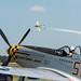 P-51 Mustang awaiting  De Havilland Vampire to finish run at Airfest