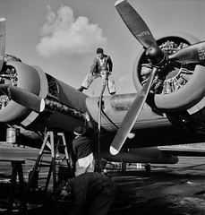 Lubricating and servicing a new B-17F (Flying Fortress) bomber for flight tests at the airfield of Boeing's Seattle plant. 1942. (polkbritton) Tags: andreasfeininger 1940s worldwarii airplanes seattlehistory fsaowi libraryofcongresscollections wwiihomefront