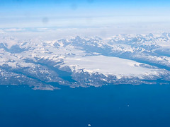 Aerial view of the coast and fjords of Greenland on flight from KEF to YUL (mbell1975) Tags: kujalleq greenland gl aerial view coast fjords flight from kef yul grønland atlantic ocean fjord mountain mountains landscape paysage sea inlet channel strait water cliff cliffs snow covered