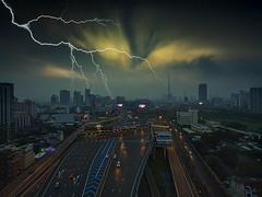 The coming storm (grantthai) Tags: bangkok thailand storm lightning expressway road building buildings vehicles cars strike thunder thunderstorm