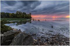 Distant Storm (etzel_noble) Tags: leefilter canon1740mm canon6d lake landscapephotography naturephotography michigan sunrisephotography canonphotography clouds landscape nature lakeerie storm sunrise