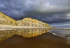 Dancing and Fire (pauldunn52) Tags: traeth mawr cliffs reflections storm clouds glamorgan heritag coast wales wet sand