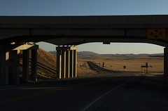 Highway & Byway (JasonCameron) Tags: underpass road drive signs sunset light angle fork cement structure