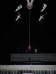 Acrobats in the air (RIch-ART In PIXELS) Tags: culturanova heerlen culturanovainternationaaltheaterfestivalheerlen theatre spectacle outdoor leicadlux6 dlux6 zuidlimburg thenetherlands building night sky art carillon theflightoftime lines