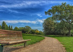 Time to relax! 😊 (LeanneHall3 :-)) Tags: bench brown walkway treetrunk trees branches green leaves field park blue sky skyscape white clouds cloudsstormssunsetssunrises eastpark hull kingstonuponhull landscape canon 1300d groupenuagesetciel