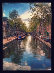 Amsterdam. (notkossi) Tags: outdoors reflection canal water landscape city bridge waterway outdoor travel narrow photo amsterdam noperson river sky lake boat bodyofwater small sight painting nature watercourse side evening long bank surrounded channel filled tree bayou
