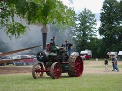 Case, with phone (joeldinda) Tags: 4190 2018 activities cloud dirtroad drive driveway em1 em1ii eatoncounty farmequipment fire july lawn michigan michigansteamengineandthreshersclubgrounds michigansteamengineandthreshersclubreunion omd omdem1mkii olympus people person road sky smoke tractor tree unpaved
