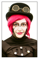 Steampunk girl (Photography And All That) Tags: girl steampunk lincoln lincolnsteampunkweekend asylum goggles hat hats makeup costume costumes cosplay tophat portrait portraits portraiture colour colours colourful sony sonyalpha7mark3 sonyilce7m3 sonyalpha ilce7m3 stranger pink face faces facepaint greasepaint smile smiles smiling headandshoulders head shoulders expression expressions whitephotoborder lincs lincolnshire eyes eyecontact eye gaze fun humour festival festivals event events