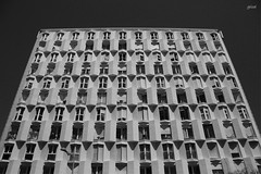 weapon against nature (gicol) Tags: building palacio palazzo edificio architettura urbana città city ciudad barcelona spain catalunya simmetria symmetry finestre window ventana ombre sombras shadow