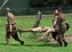 See What War Does! (Tim7778) Tags: army war medics wounded treetrunk uniforms stretcher outdoors people