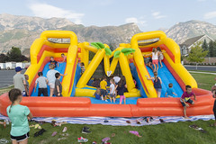 Too Many Jumpers (aaronrhawkins) Tags: bounce bouncehouse jump kids children boy girl play slide fun church crowd crowded crush impatient provo utah kellie colorful inflate inflatable rent aaronhawkins