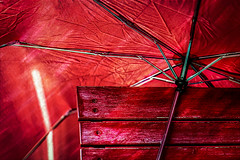 Red on Red (Natalia Medd) Tags: red umbrella garden chair sun bright texture contrast