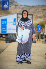 A women with her Qurbani meat portion in Lebanon.