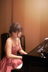 Young female musician playing piano in concert hall (Apricot Cafe) Tags: img92878 acousticmusic adultsonly asia asianandindianethnicities beautifulpeople canonef85mmf14lisusm classicalconcert classicalmusic classicalmusician expertise japan japaneseethnicity liveevent musicalinstrument performingartsevent skill stageperformancespace tokyojapan artscultureandentertainment cheerful concentration concert concerthall cooperation dress elegance flute formalwear groupofpeople happiness individual indoors lifestyles lightingequipment music musician oneperson onlywomen performance pianist piano playing realpeople serenepeople sideview sitting success teamwork women youngadult