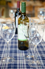 Wine bottles and gasses on a table (Nourish Scotland) Tags: glasses wine bottles red white empty reflections clean drinks alcohol drinking tables tablecloths tartan blues scotland scottish uk britain greatbritain british europe european photobyrosgasson gbgbr826