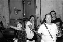 (Vrenzole) (Robbie McIntosh) Tags: leicam9p leica m9p rangefinder streetphotography 35mm leicam autaut candid strangers leicaelmarit28mmf28iii elmarit28mmf28iii elmarit 28mm man woman flash shutterdrag draggingtheshutter blackandwhite monochrome bw religion napoli naples