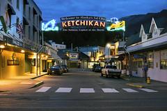 Welcome to Alaska's 1st City (Curtis Gregory Perry) Tags: ketchikan alaska sign neon night long exposure downtown city mission street fisherman fishing crosswalk light salmon capital world first 1st market shop store souvenir nikon d810 inside passage