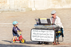 Play for God and for you (Elenovela) Tags: street streetlife strasenmusik musiker musician kind child fahrrad piano summer sommer outdoor candid trier germany musik music olympusem1 olympus50200mmf2835 elenovela karstenmüller
