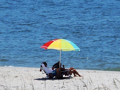 Relaxing on the Beach (ckorfanty) Tags: beach relax sand water blue stgeorgeisland umbrella rainbow